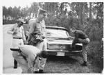 MU Engineering Prof. Thomas W. Olson (foot on car) on exploration of the Everglades