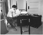 MU Business Prof., Dr. Phyllis Cyrus at new desk, Feb., 1969
