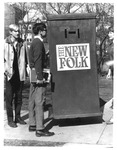 Doug Huges & Ed Jordan putting up signs for folk-rock group
