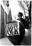 MU junior Jim Robinson sending up balloons for folk-rock group