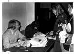 Handing our Chief Justice yearbooks at MU Student Uhion, Oct. 1975