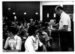 Chem. Professor Dr. Edward Hanrahan lecturing Chem. class