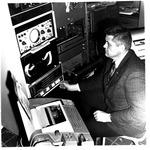 MU Chem Professor George Phillips operating the DEC PDP-8 digital computer