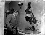 MU Journalism Prof. W. E. Chilton examines piece of photographic equipment