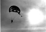 Santa Clause parachutting down onto Huntington Mall Sears,
