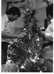 Mu Soph. Tom Clark (r) & Kent Wellman (l) decorate Christmas tree in Twin Towers