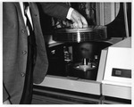 Removing a disk pack from the IBM 3211 computer disk storage drive