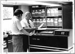 Steve Adkins & Marvin Fulton operate Marshall's Data 100 terminal