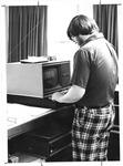 Operator inputting data in Marshall's Data 100 terminal