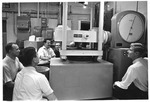 Dr. T. W. Olson's Enginering Class, using stress testing machine, 1968