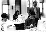 MU Journalism Prof. Wayne Davis assisting students, 1993