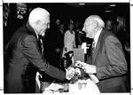 MU Journalism Prof. W.Page Pitt, left shakes hands with MU Pres. Stewart Smith