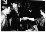 MU Journalism Prof. W.Page Pitt, left shakes hands
