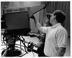 MU Journalism student Maureen Mach operating the large video camera, ca. 1991