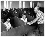 Mu Spanish Prof. Harold T. Murphy, instructing in the Languarge Listening Lab