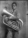 African-American youth holding a large horn