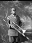 African-American youth holding trombone