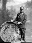 African-American youth holding drum inscribed with the phrase,