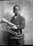 African-American youth holding horn by Proctor Studios