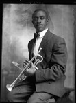 Young African-American man holding a trumpet