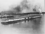 Steam towboat Arthur Hider moving an entire town down the Ohio River, 1944