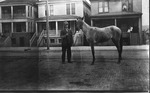 Leroy Willey or his father with horse, ca. 1910