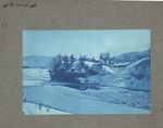 Unidentified location, snow scene with house on bluff
